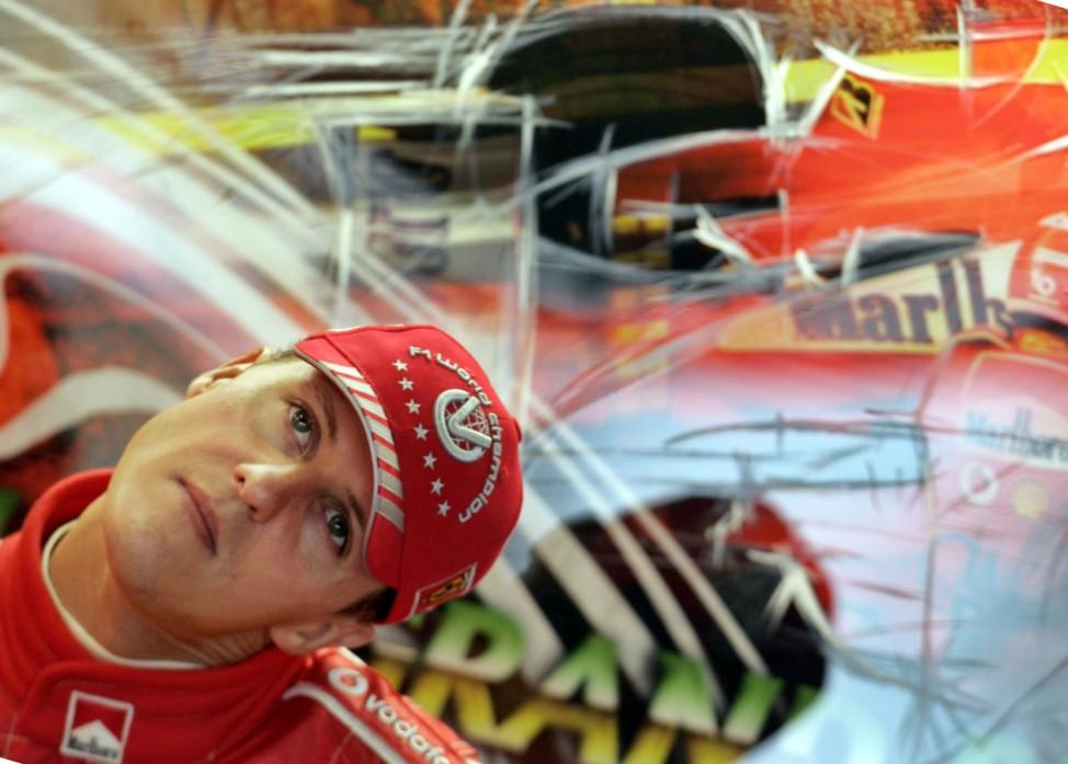 Ferrari F1 driver Schumacher stretches before free practice at Brazil GP