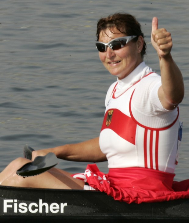 Germany's Birgit Fischer thumps up after crossing the finish line to win the women K4 500 meter race in Athens