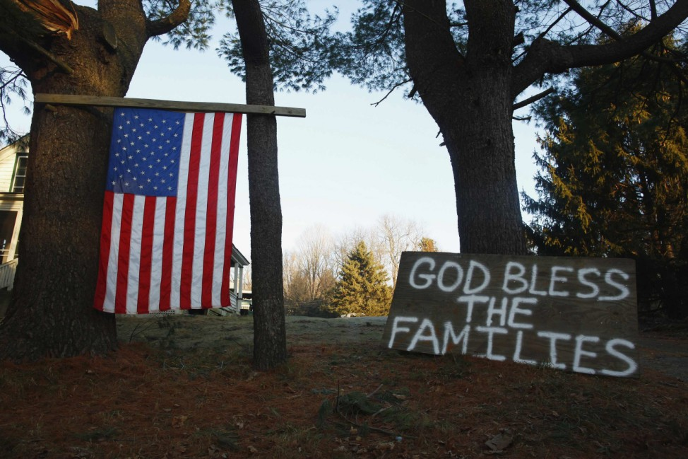 A sign and a U.S. national flag are seen near Sandy Hook Elementary School in Sandy Hook in Newtown