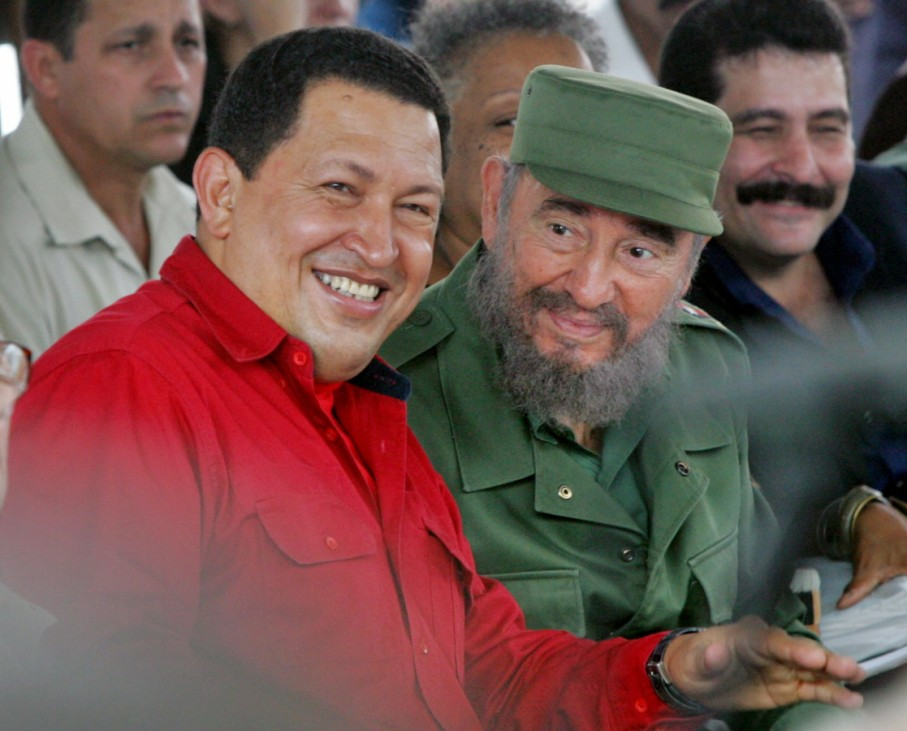Cuba's President Castro and his Venezuelan counterpart Chavez listen to musicians during the opening of the International Book Fair in Havana
