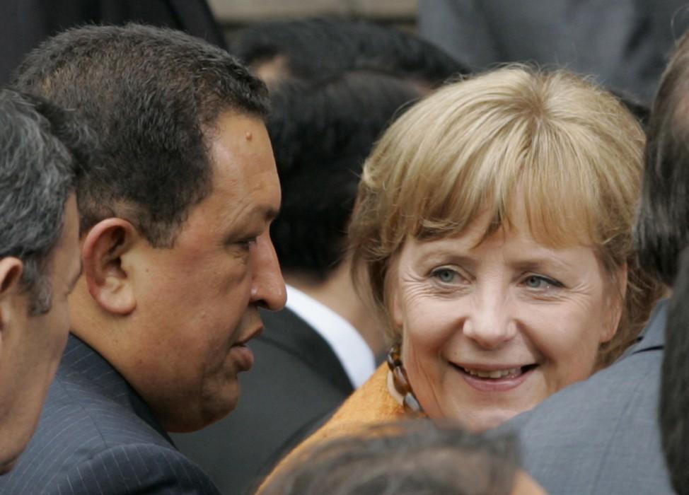 German Chancellor Angela Merkel walks alongside Venezuelan President Hugo Chavez in Lima
