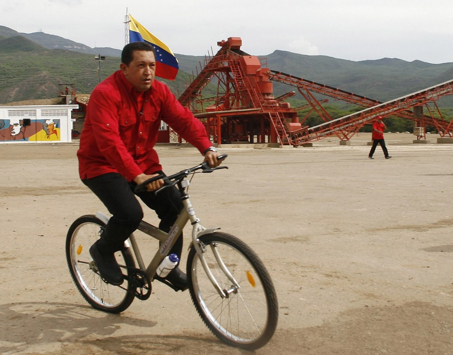 Venezuelan President Chavez rides bicycle during 'Aló President' transmitted from Chema Saher in Falcon state