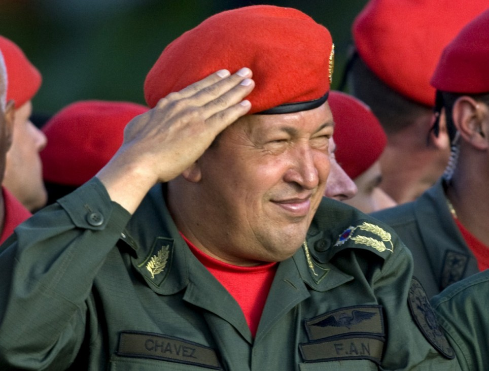 Venezuela's President Hugo Chavez salutes after arriving at a military parade in Maracay