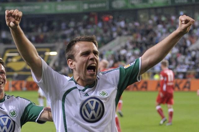 VfL Wolfsburg's Misimovic celebrates after scoring against VfB Stuttgart during their German first division Bundesliga soccer match in Wolfsburg