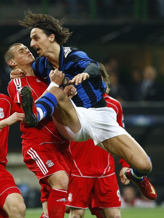 Inter Milan's Ibrahimovic is challenged by Liverpool's Skrtel during their Champions League soccer match in Milan