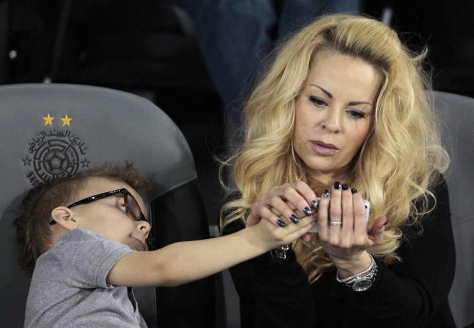 Paris Saint-Germain player Ibrahimovic's girlfriend Seger and their son attend his team's friendly soccer match against Lekhwiya in Doha