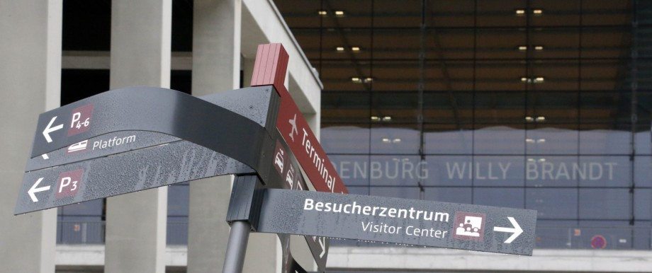 A damaged sign is pictured at the construction site of the future Berlin Brandenburg international airport Willy Brandt (BER) in Schoenefeld
