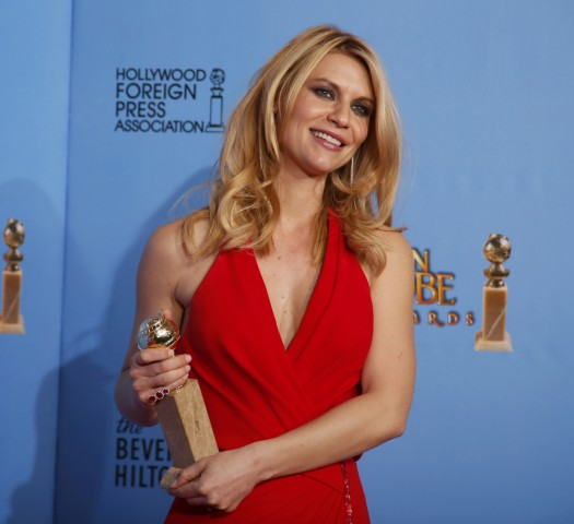 Claire Danes, winner for Best Actress in a Television Series, Drama for 'Homeland,' poses with award backstage at the 70th annual Golden Globe Awards in Beverly Hills