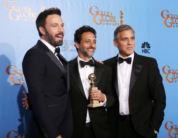 Producer and director Affleck poses with 'Argo' producers Heslov and Clooney after Affleck won Best Director and 'Argo' won Best Motion Picture Drama at the 70th annual Golden Globe Awards in Beverly Hills