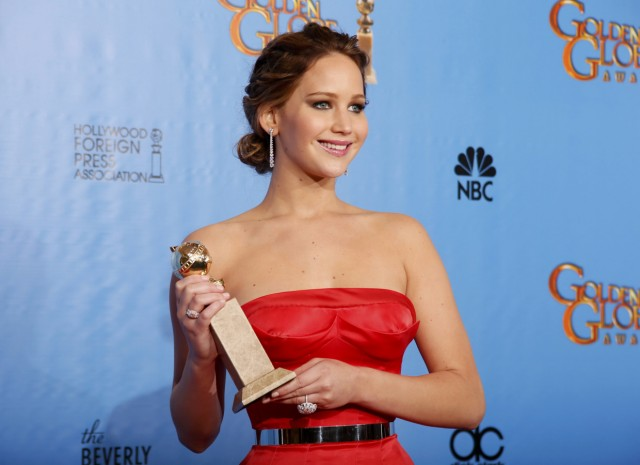 Jennifer Lawrence holds the award she won for Best Actress in a Motion Picture, Comedy or Musical for her work in 'Silver Linings Playbook' backstage at the 70th annual Golden Globe Awards in Beverly Hills
