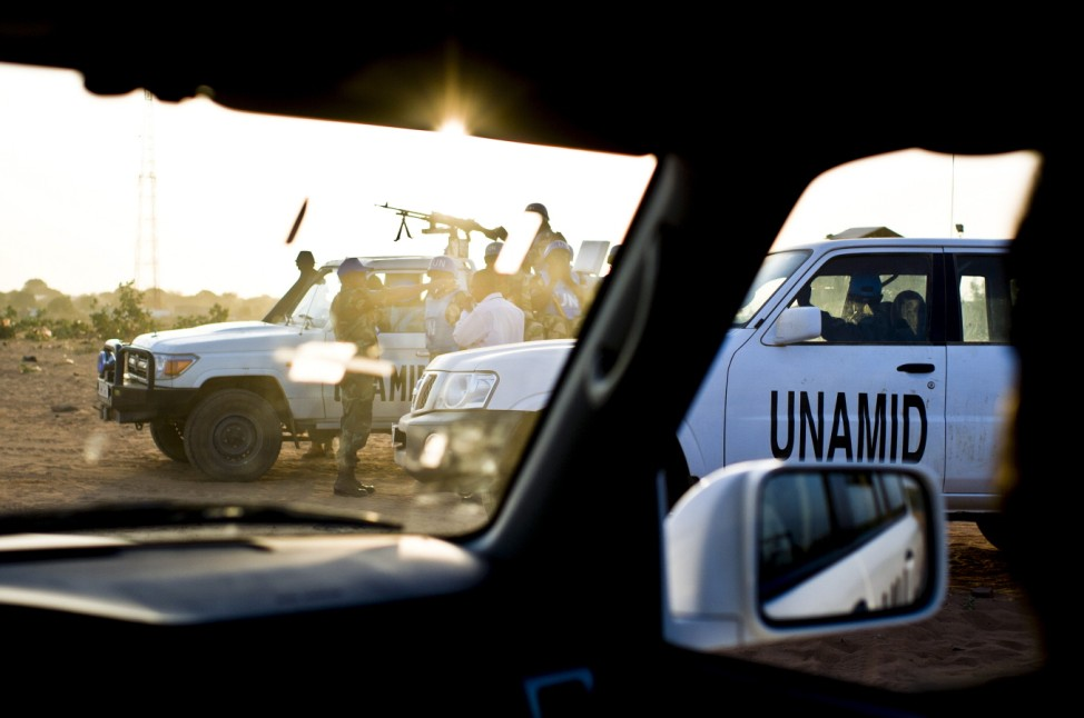 UNAMID peacekeepers patrol through Nyoro, Sudan.