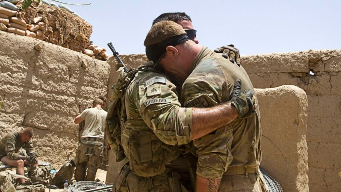 U.S. Army soldiers react after their comrade was wounded at patrol by an IED in southern Afghanistan