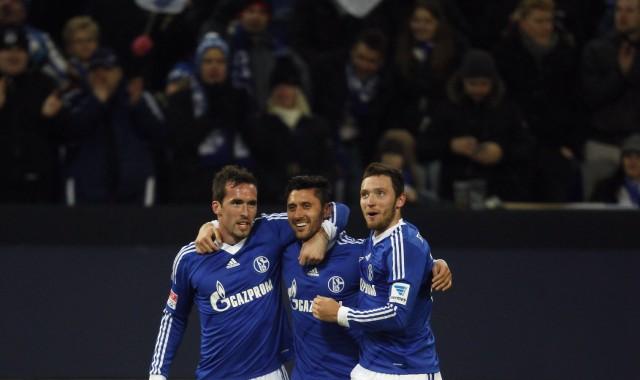 Schalke 04's players celebrate a goal against Hannover 96 during the German first division Bundesliga soccer match in Gelsenkirchen