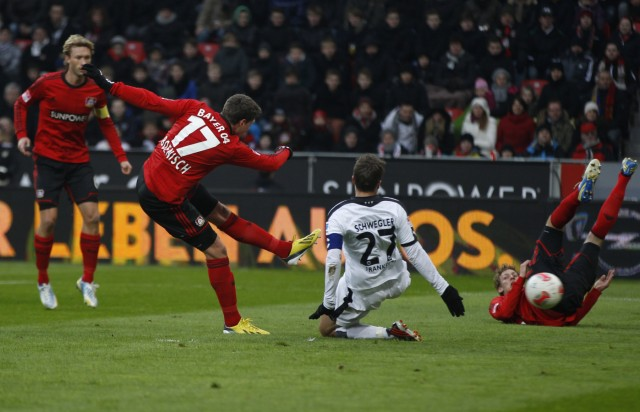 Bayer Leverkusen's Boenisch scores a goal against Eintracht Frankfurt during the German first division Bundesliga soccer match in Leverkusen