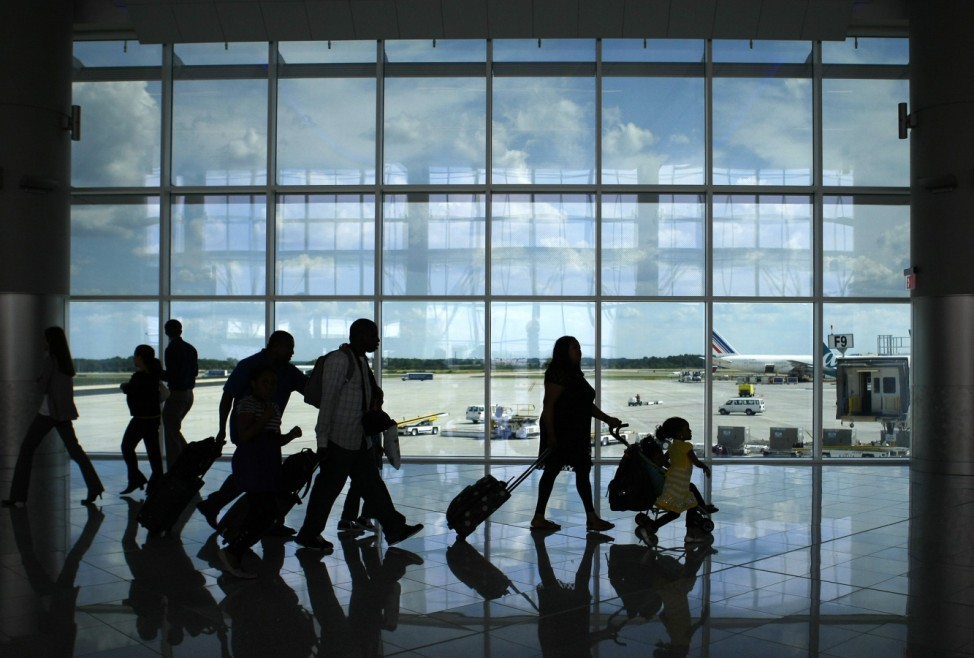 Passengers walk through the newly opened Maynard H. Jackson Jr. International Terminal in Atlanta, Georgia