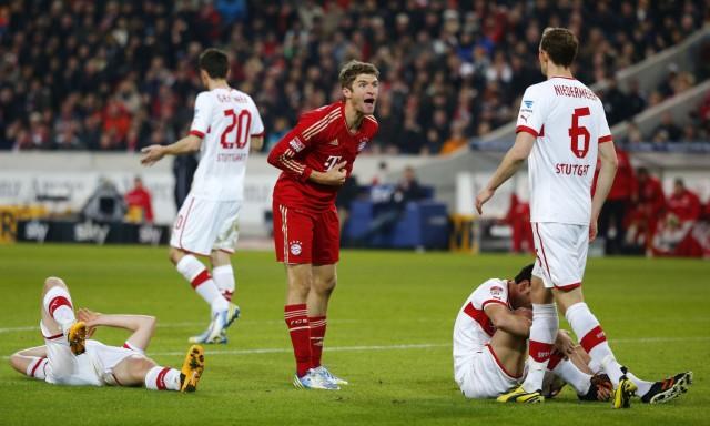 Thomas Mueller of Bayern Munich argues with Georg Niedermeier of VfB Stuttgart during their German first division Bundesliga soccer match in Stuttgart