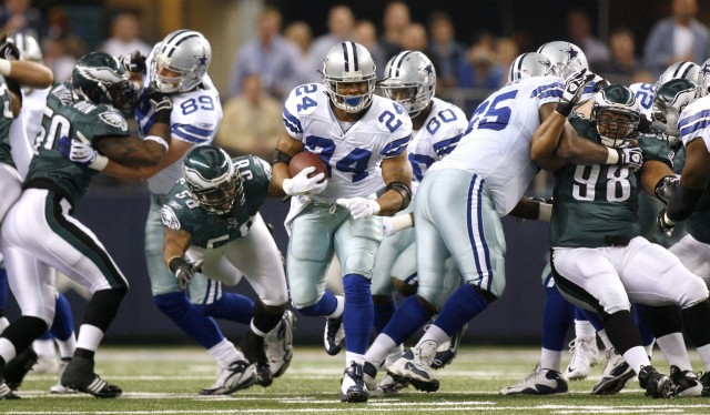 Cowboys running back Barber breaks through the line against the Eagles NFL football game in Arlington