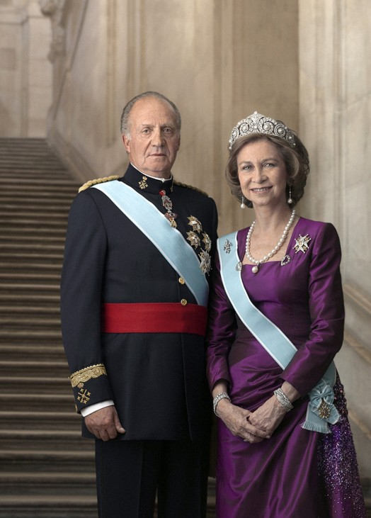 Handout released by the Spanish Royal House show Spain's King Juan Carlos and Queen Sofia posing for their new official portraits