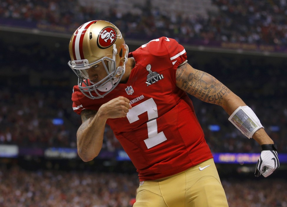 San Francisco 49ers quarterback Colin Kaepernick celebrates his fourth quarter tochdown against the Baltimore Ravens in the NFL Super Bowl XLVII football game in New Orleans
