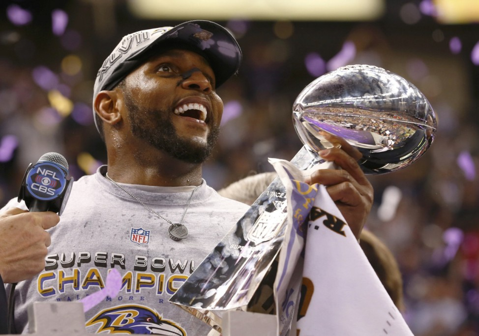 Ravens Lewis celebrates with the Vince Lombardi trophy after the Ravens defeated the 49ers to win the NFL Super Bowl XLVII football game in New Orleans