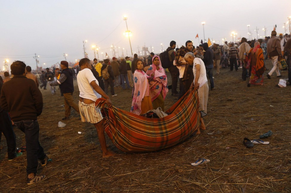 Pilgrims move locations during the second 'Shahi Snan' of the ongoing 'Kumbh Mela' or Pitcher Festival in Allahabad