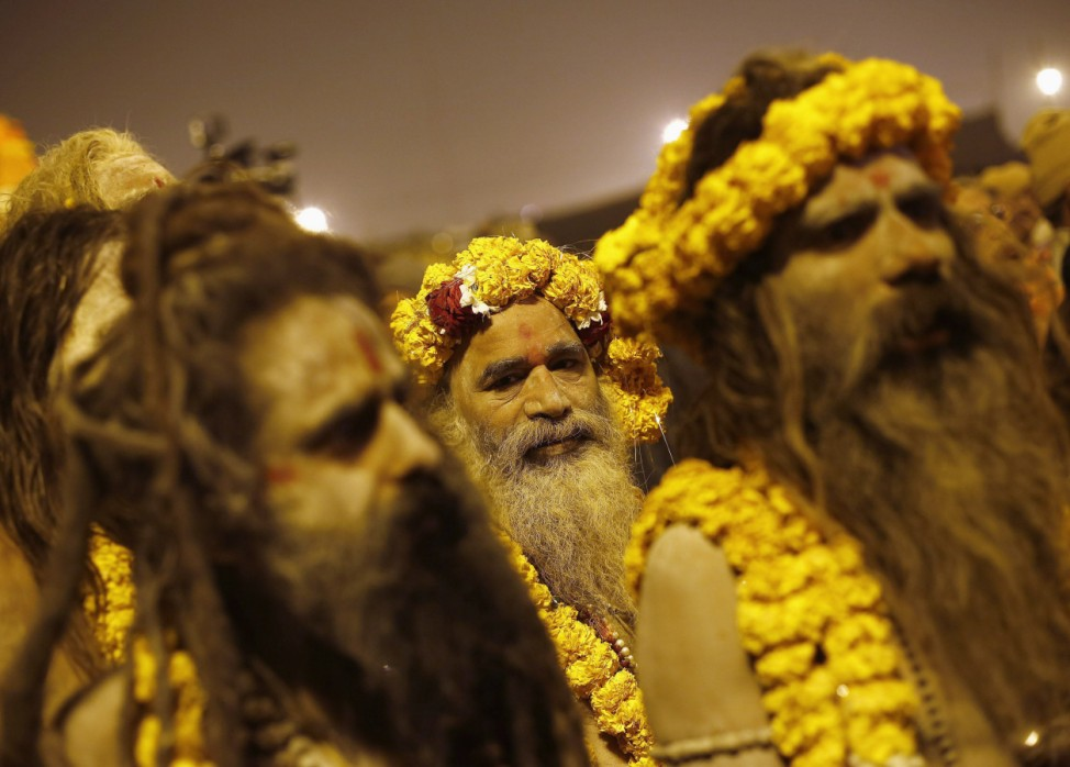 Sadhus or Hindu holy men prepare to take a dip during the second 'Shahi Snan' of the ongoing 'Kumbh Mela' in Allahabad