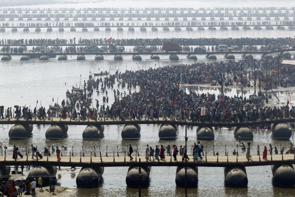 Hindu devotees cross the river Ganges during the ongoing 'Kumbh Mela' in Allahabad