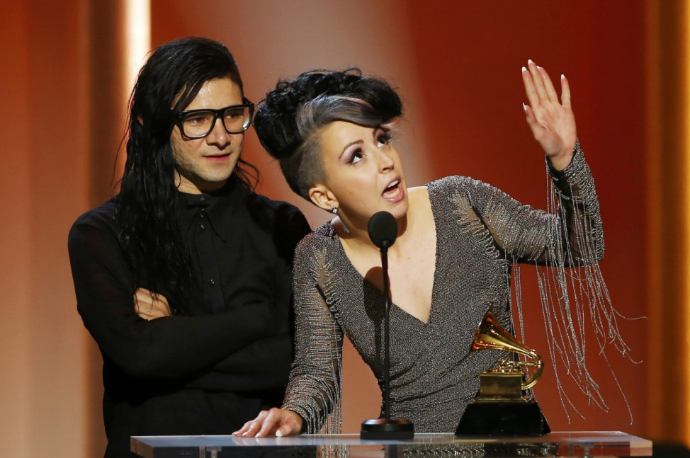 Skrillex and Sirah accept their award for best dance recording for their work 'Bangarang' in 55th annual Grammy Awards in Los Angeles