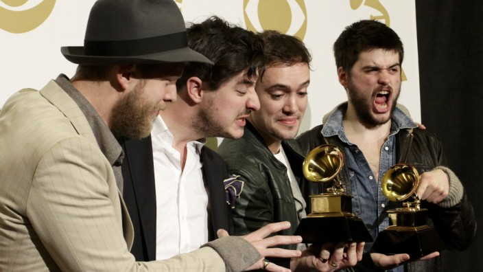 Mumford & Sons pose with their awards for Album of the Year and Best Long Form Music Video at the 55th annual Grammy Awards in Los Angeles