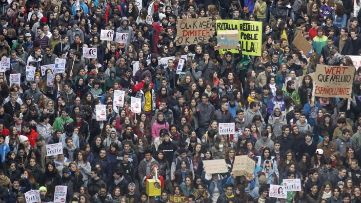 Members of the student's union march as they protest against public education spending cuts in Barcelona