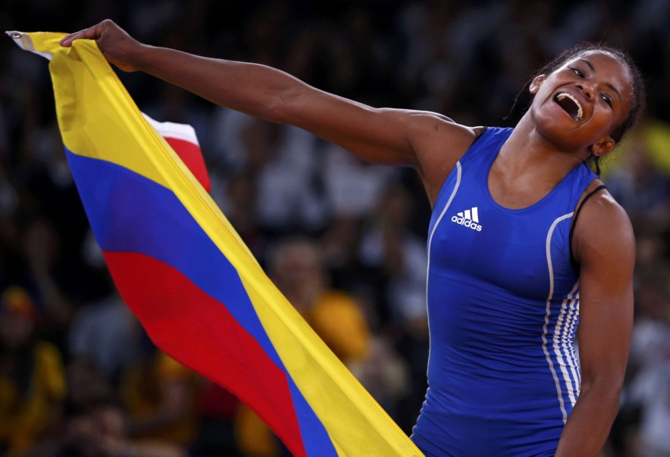 Colombia's Jackeline Renteria Castillo celebrates after defeating Ukraine's Tetyana Lazareva for the bronze medal of the Women's 55Kg Freestyle wrestling at the ExCel venue during the London 2012 Olympic Games