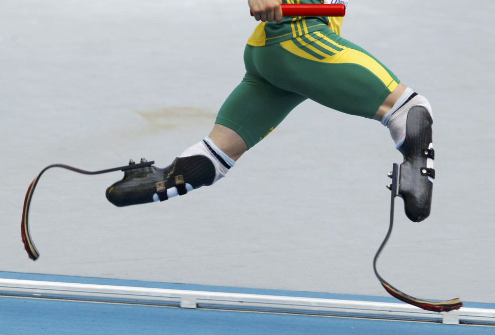 Pistorius runs with the baton during his men's 4x400 metres relay heat at the IAAF World Athletics Championships in Daegu