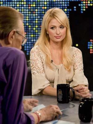 Paris Hilton, Larry King, AFP