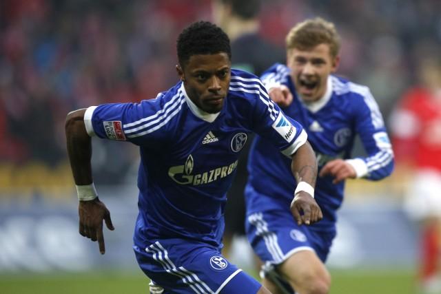 Schalke 04's Bastos reacts next to team mate Meyer after scoring a goal against FSV Mainz 05 during their German first division Bundesliga soccer match in Mainz