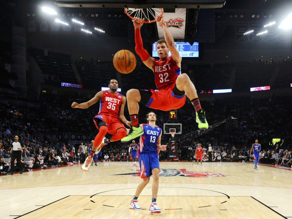 NBA All-Star Griffin of the Clippers dunks as teammate Durant and All-Star Noah of the Bulls look on during the 2013 NBA All-Star basketball game in Houston