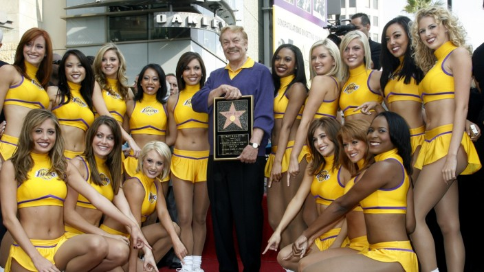 File photograph of Laker Girls posing as Los Angeles Lakers owner Jerry Buss receives a star on the Hollywood Walk of Fame in Hollywood
