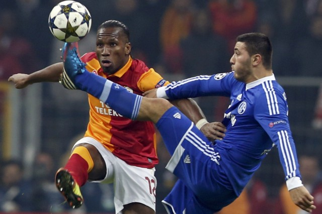 Galatasaray's Drogba is challenged by and Schalke 04's Kolasinac during their Champions League soccer match in Istanbul