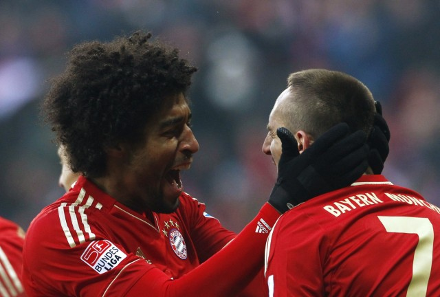 Bayern Munich's Ribery and Dante celebrate goal during German Bundesliga first division soccer match against Werder Bremen in Munich
