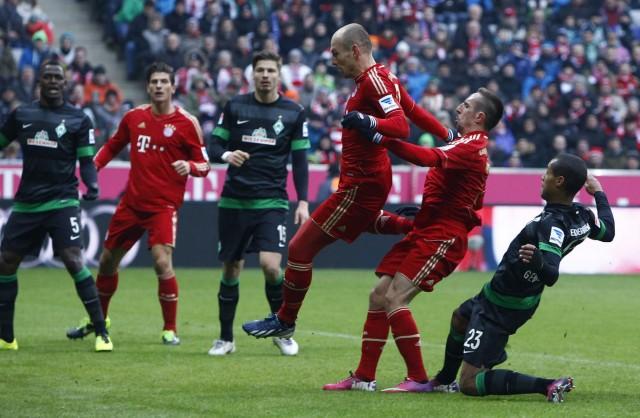 Bayern Munich's Robben scores oal next to team mate Ribery during German Bundesliga first division soccer match against Werder Bremen in Munich