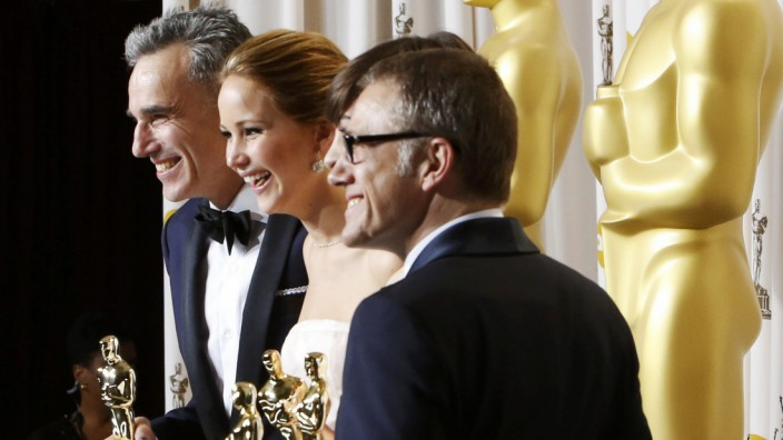 Oscars, Day-Lewis, Lawrence, Hathaway and Waltz pose with their Oscars backstage at the 85th Academy Awards in Hollywood