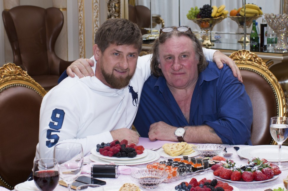 Actor Depardieu poses for a picture with Chechen President Kadyrov during a meeting at the presidential residence in Grozny