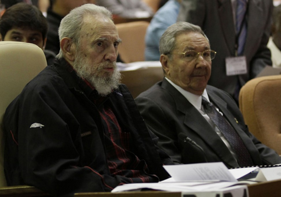 Former Cuban leader Fidel Castro attends the opening session of the National Assembly of the People's Power with brother Raul in Havana
