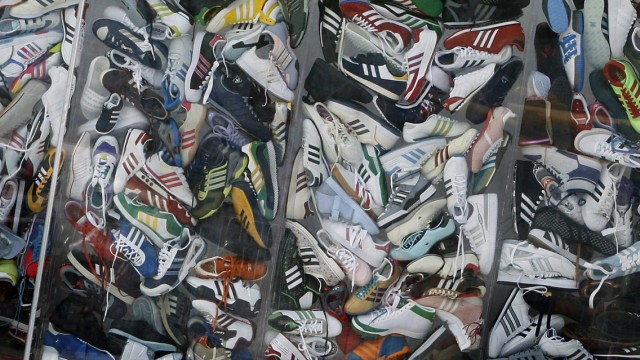 File photo of Adidas shoes are piled up in a display window at the new Adidas Brand Center store in Beijing