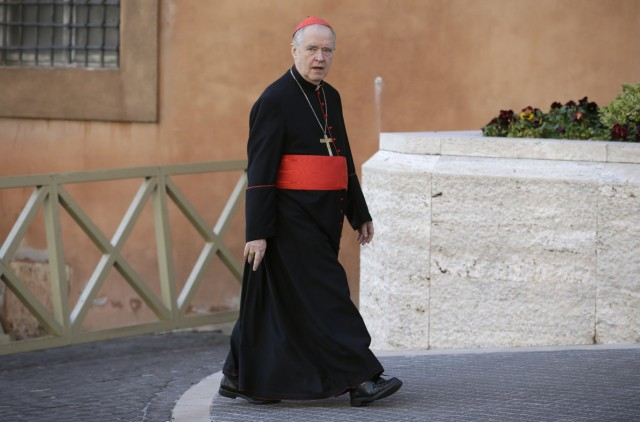 German Cardinal Cordes arrives for a meeting at the Synod Hall in the Vatican