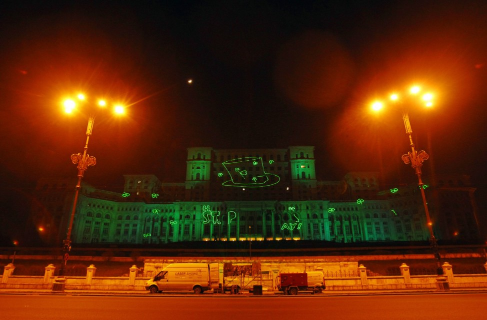 Romania's Parliament Palace is seen illuminated in green light ahead of St Patrick's Day, in Bucharest