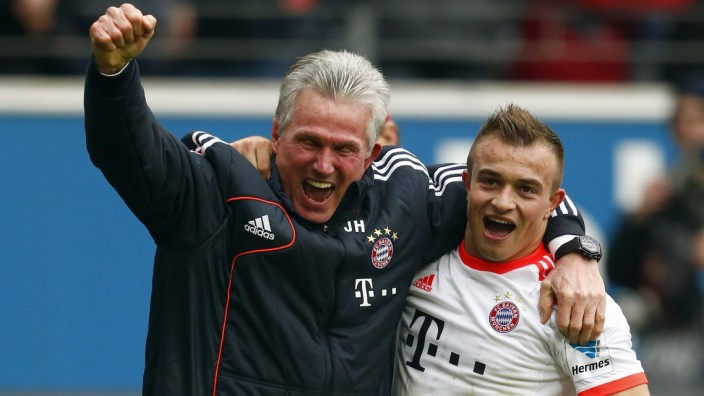 Munich's coach Heynckes and player Shaqiri celebrate after winning Bundesliga soccer match against Eintracht Frankfurt and German soccer Championships in Frankfurt