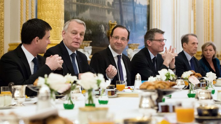 French Interior Minister Valls, Prime Minister Ayrault, France's President Hollande and Education Minister Peillon pose prior to a meeting at the Elysee Palace in Paris