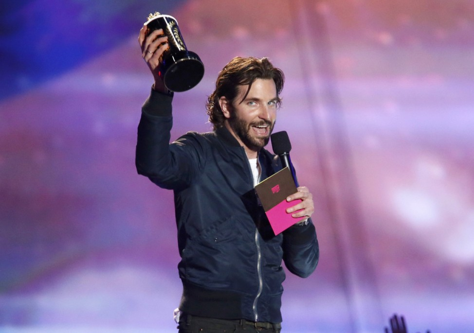 Bradley Cooper accepts the award for best kiss at the 2013 MTV Movie Awards in Culver City, California