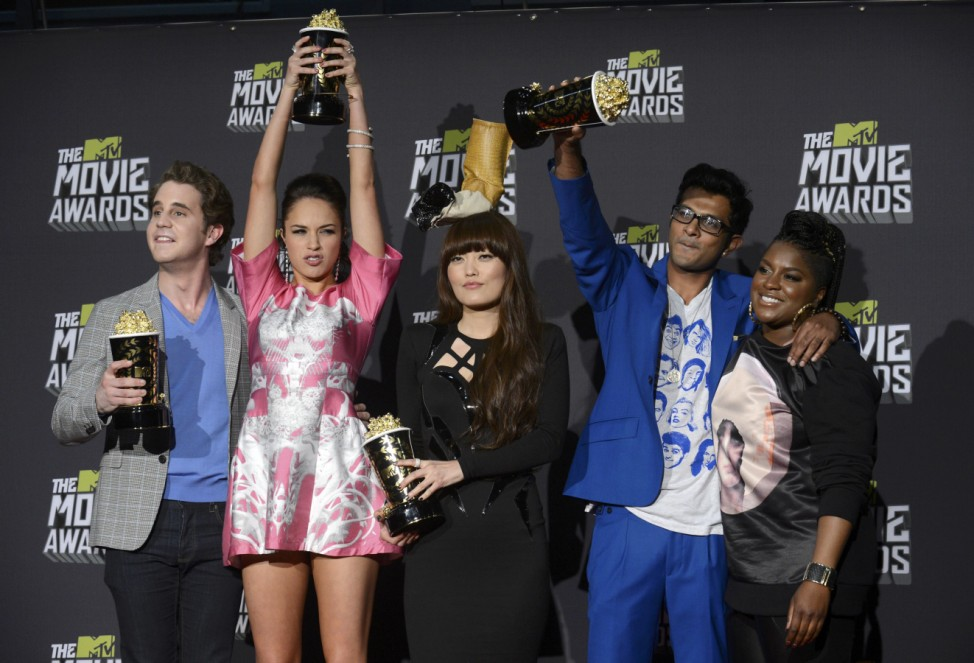 Cast members from 'Pitch Perfect' pose with their awards for best musical moment at the 2013 MTV Movie Awards in Culver City, California