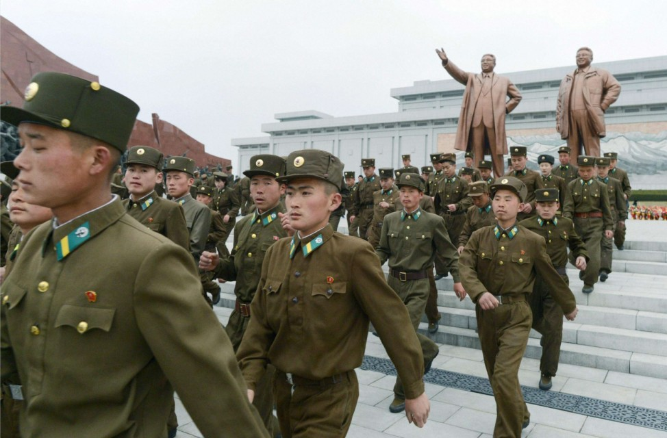 North Korean soldiers visit the bronze statues of North Korea founder Kim Il-sung and late leader Kim Jong-il at Mansudae in Pyongyang